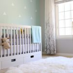 Nursery With Blue Painted Wall, White Wooden Crib, White Fury Rug