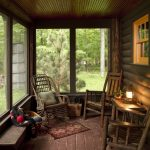 Rustic Porch With Wooden Flooring, Wall, Ceiling With Wooden Rocking Chair, Wooden Chairs With Wooden Side Table, And Wooden Bench