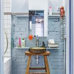 Small Bathroom With Blue Painted Bricks, Blue Painted Wall, Copper Sink Supported By Wooden Stool, White Tiles Bathtub, Mirror