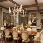 Traditional Living Room With Beige Sofa Sets, Classy Chandelier, Dining Area With Beige Leathered Chairs, Wooden Table, Antique Rugs