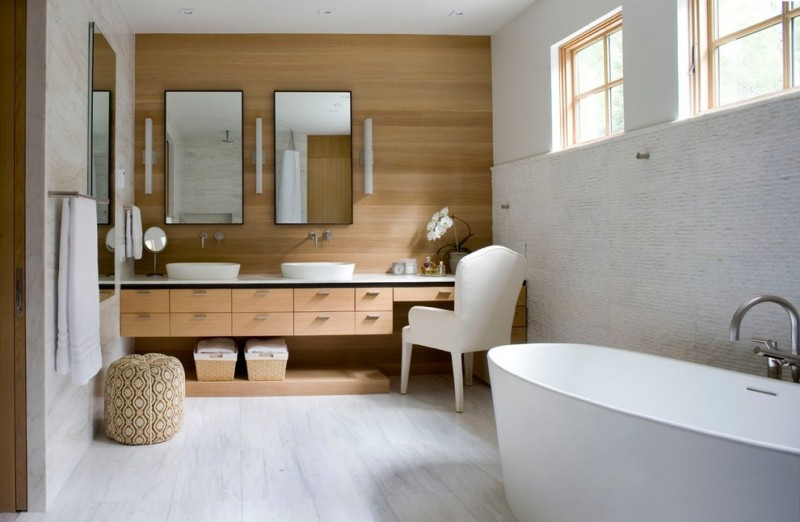 white top vanity with brown wooden cabinet with two sinks and make up counter in the right