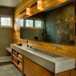 Wooden Deck Wall Bathroom Wooden Cabinet And Concrete Countertop Rectangular Mirror Sconces Mosaic Tiles Shower Wall Ceramic Tiles Floors Glass Door Shower Room
