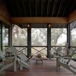 Wooden Porch With Grey Long Chairs, Grey Chairs, Raw Brown Wooden Coffee Table, Screen With Black Wooden X