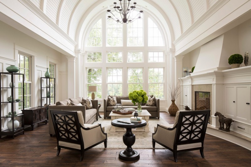Elegant formal and open concept dark wood floor living room with white walls, a standard fireplace, a tile fireplace and no tv