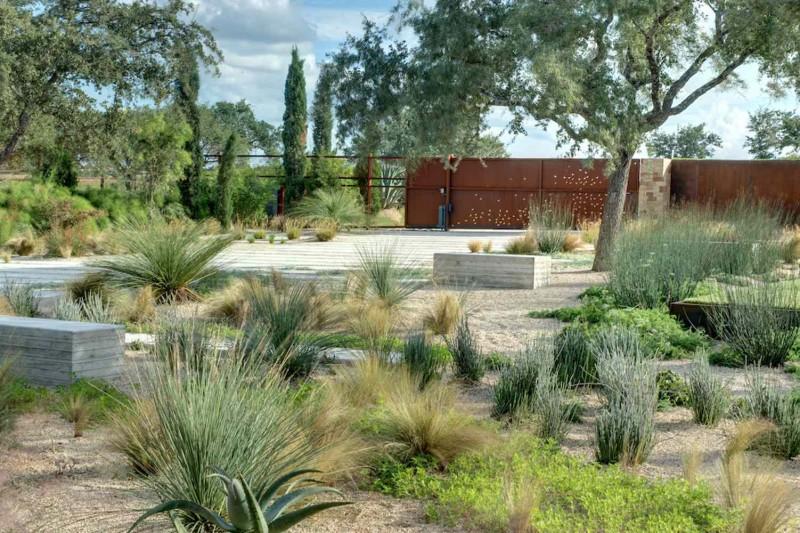 arid concrete wall concrete paving desert planters concrete bench brick