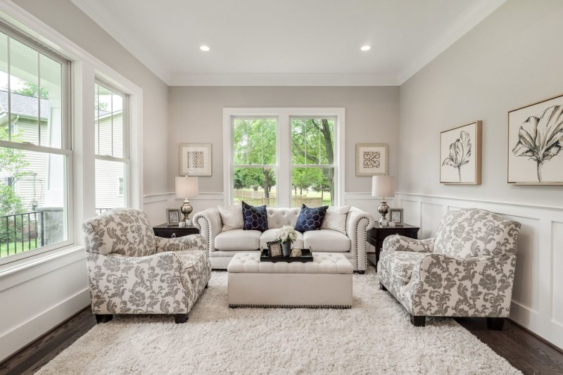 mid sized timeless formal and enclosed dark wood floor and brown floor living room with gray walls and no tv and cream rug