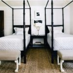 Trendy Dark Wood Floor Bedroom Cream Rug Table Lamp Black Painted Table White Wall Furnished Wooden Door Black And White Photos