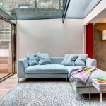 Blue Sofa Floor To Ceiling Windows Garden Glass Ceiling L Shape Sofa Powder Blue Sofa Sky Blue Sofa With Silver Leg Sliding Glass Doors Patterned Rug Silver Side Table