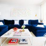 Blue Sofa White Square Coffee Table Bertoia Side Chair With White Seat Cushion Floor Lamp Indigo Sofa Cream Soft Rug White Curtain Small Pendant