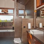 Brown Bathroom Beige Wall Brown Pendants Brown Porcelain Tile Brown Stone Countertop Built In Bathtub Floating Shelves Mahogany Cabinets Open Shelving Windows Mirror