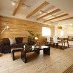 Brown Living Room Ceiling Beams Brown Wall Wide Window White Curtain Bright Wood Flooring Dark Brown Sofa Brown Coffee Tables Dining Area