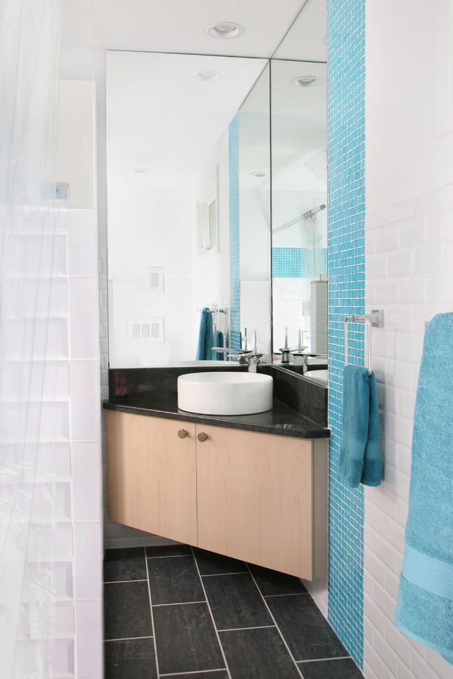 corner sink big mirrors round sink custom wooden vanity black floor tiles towel holder ocean blue and white tiles modern powder room