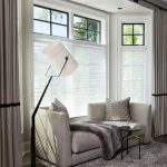 Floor Couch Floor Modern Lamp Floor Lamp Gray Drapes Shag Rug Sheer Roller Shades Small Black Side Table Throws White Lamp Window Covering