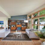 Grey Sofa Accent Wall Area Rug Clerestory Windows Credenza Table Flos Arco Floor Lamp Indoor Plants Table Lamp Large Windows Wooden Flooring