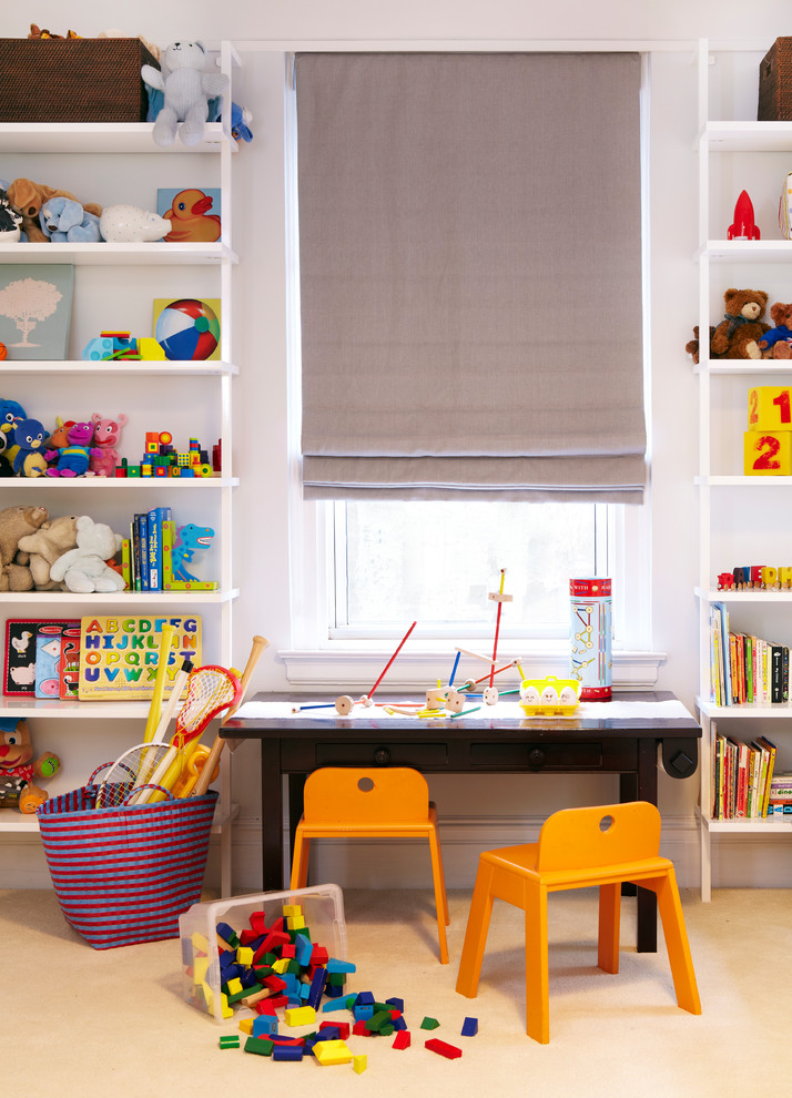 kids art table beige carpet bookshelves gray roman shade orange chairs toy storage basket low table with storage window