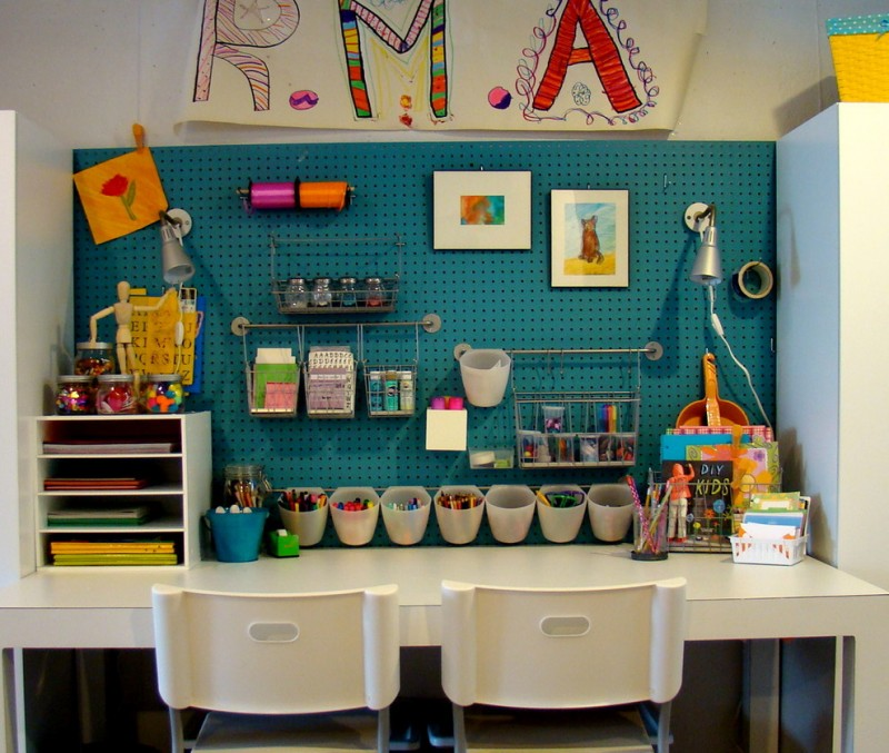 kids art table bygel wire basket bygel container and rail white built in table white chairs wall lighting open shelves