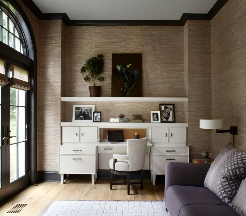 office wallpaper grasscloth wallpaper crown molding beige office chair white cabinet sofa pillows textured area rug side lamp arched windows