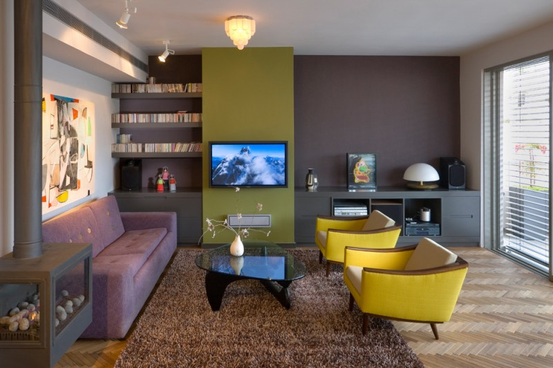 purple sofa fireplace naguchi table brown shag area rug front lamping gimbal track light low yellow armchairs with beige cushion high window with blind black cabinet ceiling lighting