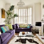 Purple Sofa Glass Coffee Table Cowhide Rug Fireplace Tv Console Colorful Pillows Windows Fireplace Mantel Crystal Chandelier