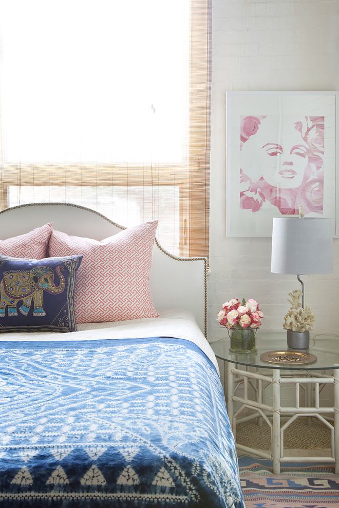 art deco bedroom artwork bed pillows glass bedside table marilyn monroe mixed prints nail head trim upholstered headboard nightstand flower arrangement colorful rug