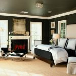 Black And White Bedding Beige Headboard Beige Rug Black Walls Ceiling Lighting Cowhide Armchair Cowhide Ottoman Dark Brown Bed Chandelier Fireplace Windows