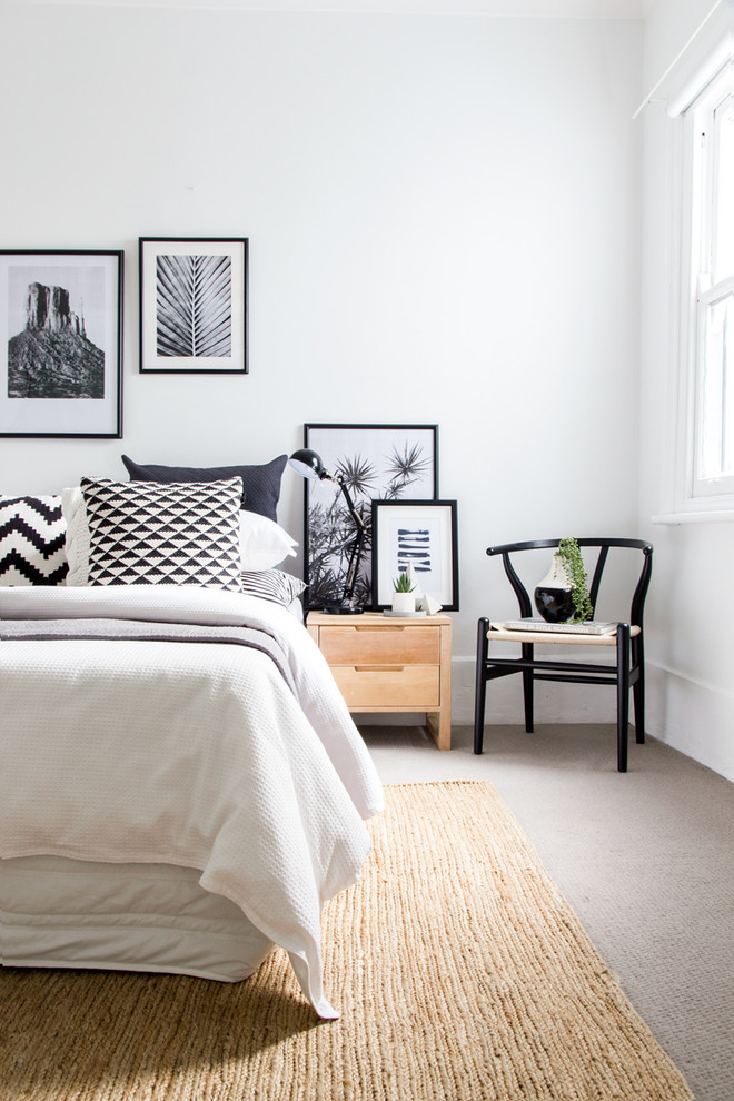 black and white bedding black and white pillow black desk lamp black framed art black wishbone chair gallery wall gray carpet