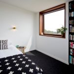 Black And White Bedding Black Bookcase Black Carpet Picture Large Window Indoor Plant Cozy Blanket Mini Wall Sconce Small Side Table