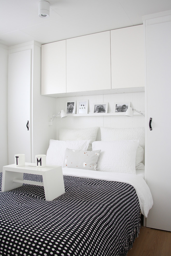 black and white bedding white built in storage coffee mugs flat panel cabinets small stool wall mounted lights white bed tray polka blanket