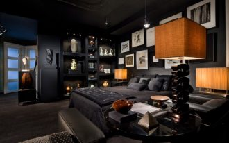 black bedroom artwork black bedding black walls frosted glass sculptures built in shelves table lamps track lights black wall shelves with recessed lighting