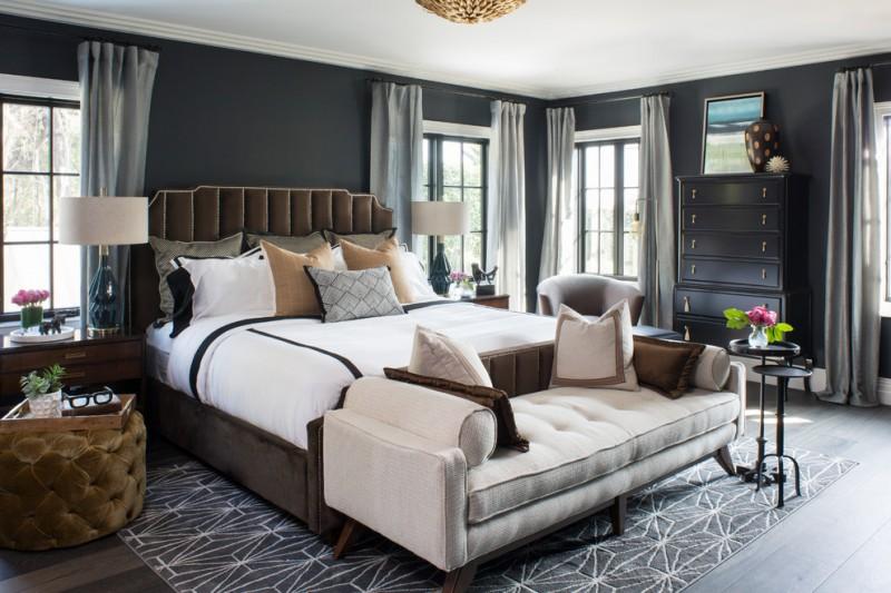 black bedroom bedroom bench beige bench black walls brown upholstered bed frame dark hardwood floors dark wood night stands geometric rug