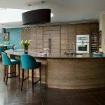 Curved Kitchen Island Blue Barstools Unique Chandelier Flat Kitchen Cabinet Undermount Sink Brown Floor Tile