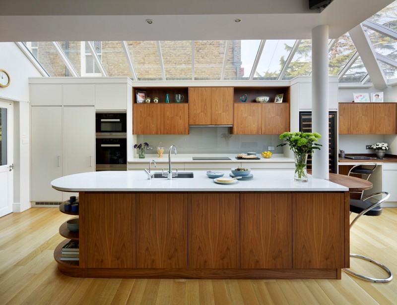 curved kitchen island glass ceilings recessed lighting white countertop wood island kitchen cabinet barstools
