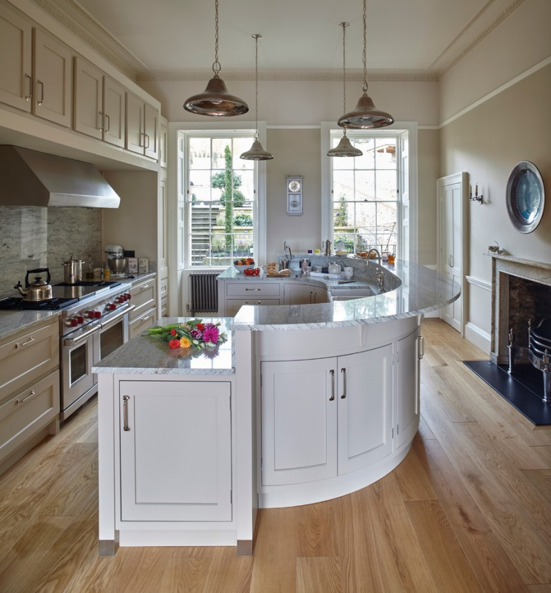 curved kitchen island granite worktops hand painted cabinet dishwasher oak flooring pendant lights sink fireplace