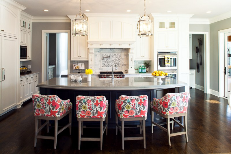 curved kitchen island patterned barstools pendant lights undermount sink white cabinet wood floor granite countertop