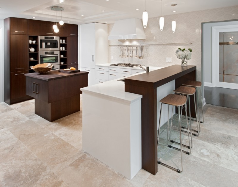 double island kitchen 3 pendants over island clean lines dark wood counters hanging kitchen utensils kitchen floor limestone barstools brown and white cabinets