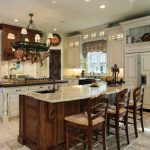 Double Island Kitchen Oil Rubbed Bronze Faucet Overhead Pot Rack Recessed Lighting Tile Floor White Cabinets Wooden Cabinets