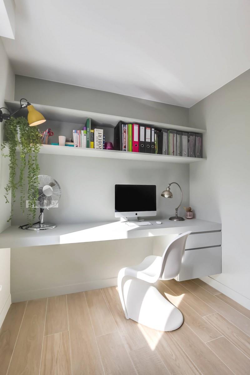 floating desk white desk white chair floating shelf open cabinet medium tone wood floor wall lamp