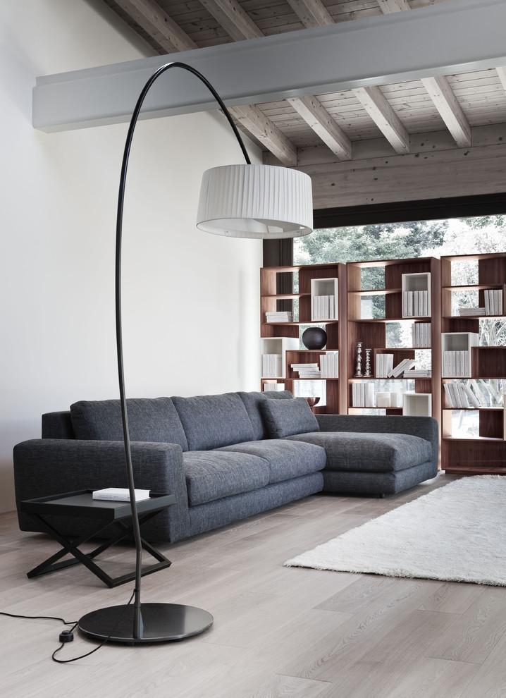 floor sofa floor lamp medium tone wood floor wood open shelving fluffy area rug dark grey modular sofa wood beams side table