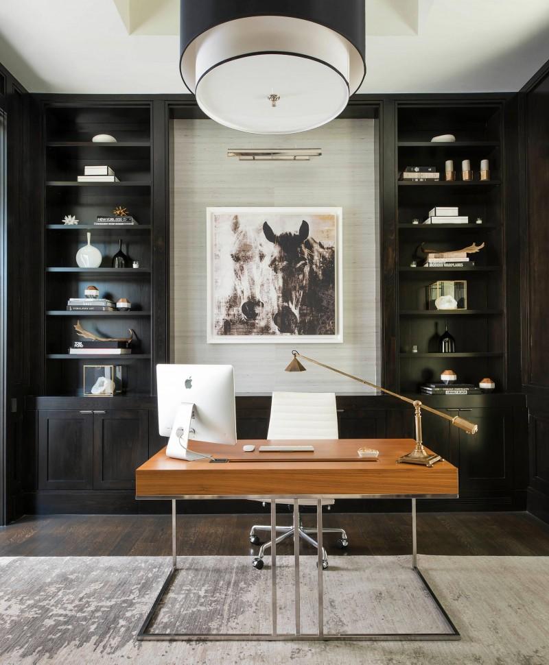 freestanding desk wooden desk red oak wooden floor textured wall open shelves black cabinet black bookcase drum shaped light table lamp