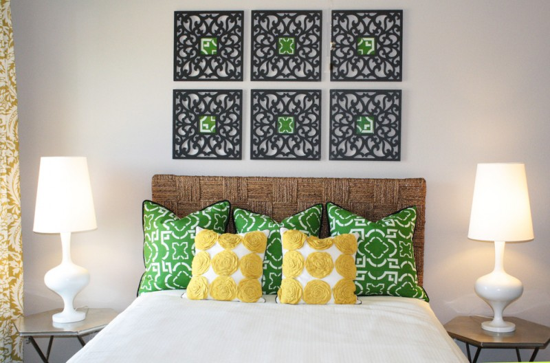 geometric wall art bedside table curtains decorative pillows drapes seagrass headboard table lamps throw pillows white bed