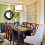 Geometric Wall Art Colorful Rug Dining Table And Chairs Mirror Pendant Green And White Wall Indoor Plant Glass Cabinet