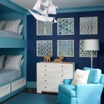 Geometric Wall Art White Frames White Drawers Blue Armchair Blue Bunk Bed Blue Rug Blue Wall White Floor Lamp Colorful Pillows
