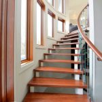 Glass Stair Railing Curved Stairs Wood Steps Small Glass Windows Beautiful Pearls Chandelier Wood Cap White Walls
