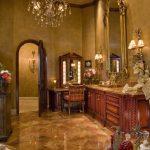 Gold Bathroom Arch Door Arch Doorway Beige Ceiling Gold Chandelier Gold Gilded Mirror Makeup Vanity Mirrored Tray Wood Vanity
