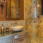 Gold Bathroom Beige Sink Double Sconce Elegant Bathroom Faucet Glass Countertop Gold Bathroom Tile Gold Faucet Gold Showerhead