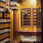 Gold Bathroom Candle Wall Sconce Colorful Wall Dark Wood Door Double Bathroom Mirror Double Bathroom Sink Gold Mosaic Tile