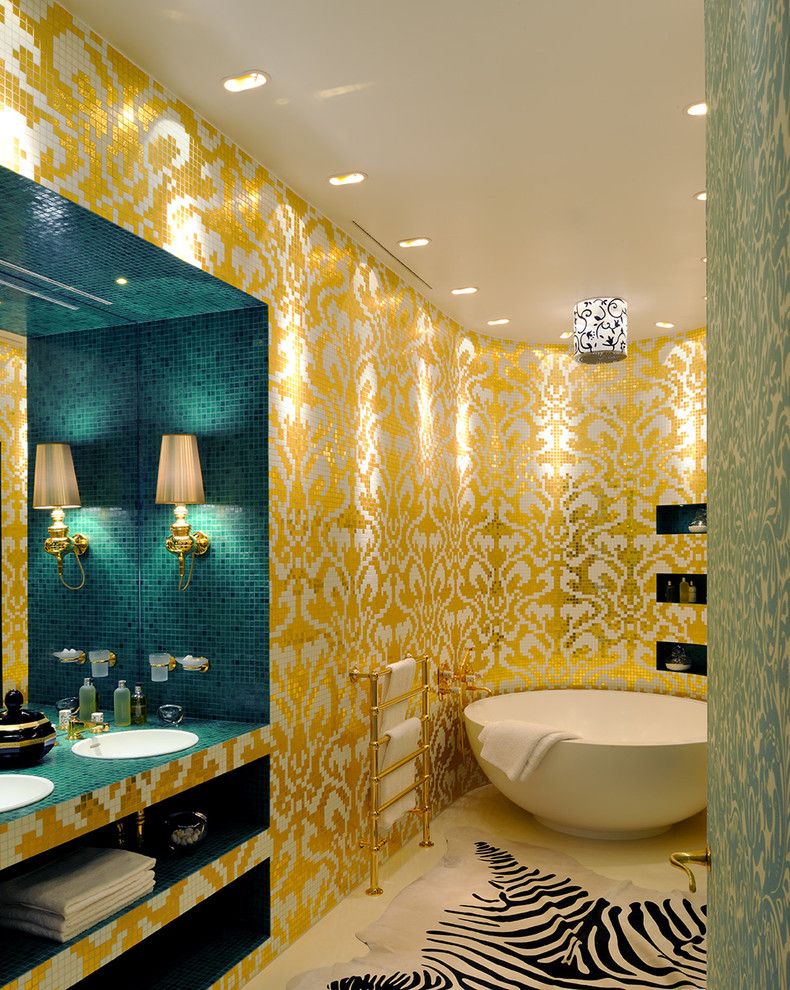 gold bathroom tub recessed wall shelves round drop in sinks teal mosaic tile counter wall sconce zebra animal hide rug