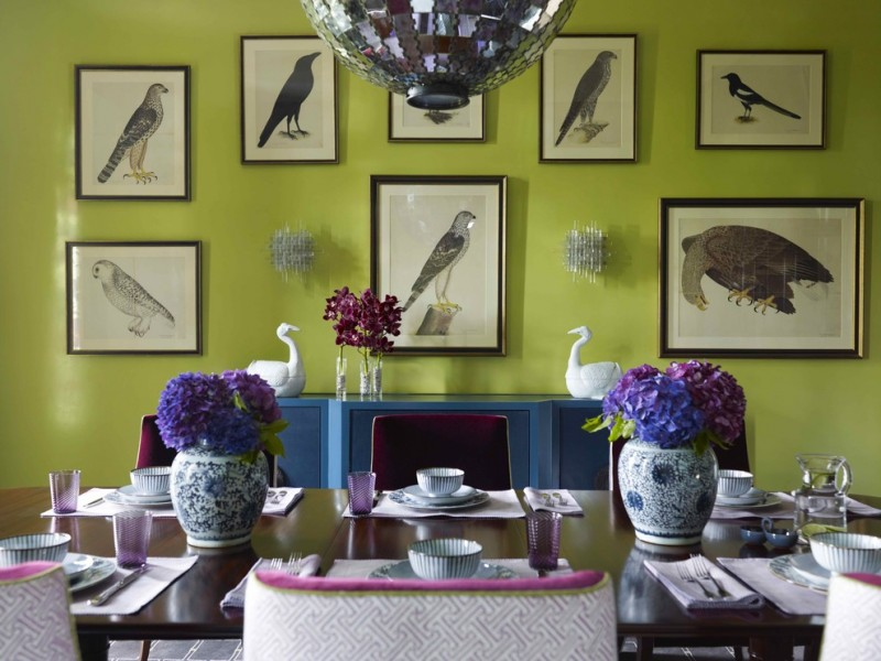 green dining room birds pictures ball chandelier blue cabinet wood table purple accent purple and white chairs wood table