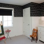 Kids Easel Alphabet Black And White Wall Chalkboard Five Paneled Door Glass Knob Glass Lamp Roman Shade Teddy Bear White Dresser Window Black Window Blind
