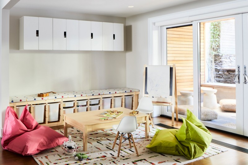 kids easel white built in cubby cabinet colorful rug floating wall cabinets kids table and chairs sliding glass doors comfy couch